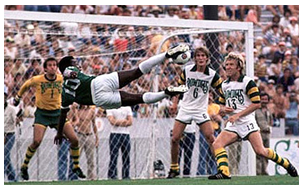 Pele takes a flying leap at the Rowdies' goal as goalie Paul Hammond, #6 Mike Connell and #13 Stewart Jump defend.